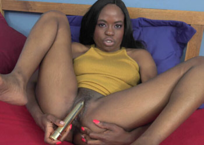 Melody's using a vibrator on her clit